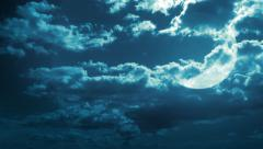 Crescent moon behind fast moving clouds. Stock Footage