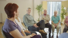 4K People in group therapy session talk about their problems together Stock Footage