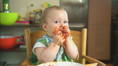 Funny child playing with spaghetti and sauce. Scene 6 Stock Footage