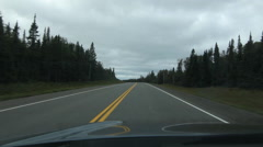 Driving on Northern Ontario highway. Truck passes at end. Stock Footage