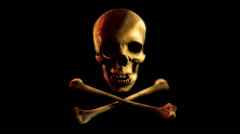Skull and bones on a black background. Pirate flag symbol. Stock Footage