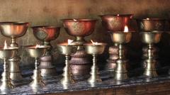 Icon-lamps in tibetan gompa. Leh, India Stock Footage
