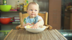 Funny child playing with spaghetti and sauce. Scene 1 - stock footage