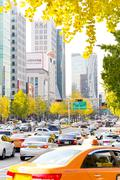 Traffic approaching on a busy road through the Gangnam district Stock Photos