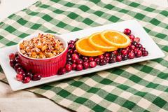 Cranberry apple relish with orange slices Stock Photos