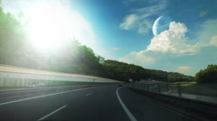 Drive down the highway with two planets visible on the horizon. Stock Footage