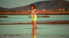 Small girl playing in the mud. Clip 3. Stock Footage