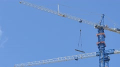 Cranes in motion 4k video Stock Footage