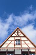 Stock Photo of gable roof of traditional german half-timbered house in medieval section of r
