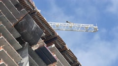 Construction crane in motion 4k video Stock Footage