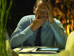 Sleepy, tired businessman yawning during work at home at night NTSC Stock Footage
