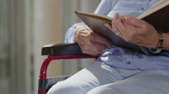4K Close up caring nurse holding hand of elderly female patient in a wheelchair - stock footage