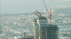 Stock Video Footage of Aerial construction cranes high elevation Dubai development UAE
