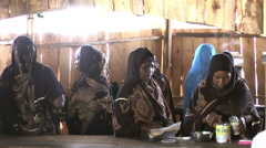 African woman prepair and eat the meal in hut Stock Footage