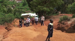 Population of small town of Tanzania. People walk on street with Caucasian peopl Stock Footage