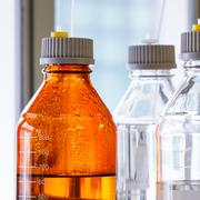 glass bottle with plastic hose - stock photo