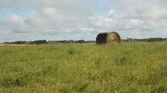 Field with hay bale. Saskatchewan, Canada. Stock Footage