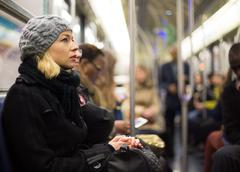 Stock Photo of Woman on subway.