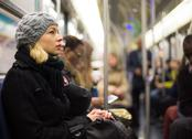 Stock Photo of Woman on subway.