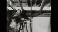 Walter Durbahn demonstrating the techniques of shelter building Stock Footage
