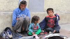 Poor family begs for money from a passerby in Leh, Ladakh, India Stock Footage