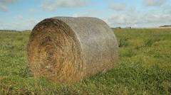 Hay bale in a field. Saskatchewan, Canada. - stock footage