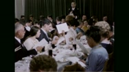 Rabbi and families preparing to sing during Passover festival Stock Footage