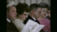 Servicemen and their family attending religious service in Belvoir Chapel Stock Footage
