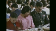Military officer and his family praying in chapel during Passover festival Stock Footage