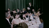 Chaplin and servicemen's families singing together at chapel Stock Footage
