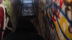 Man Climbs latter graffidi building Stock Footage