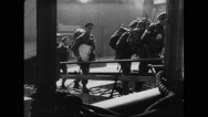 Allied soldiers boarding on ship at southern port Stock Footage