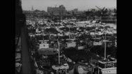 Allied ships moored at harbour of south coast Stock Footage
