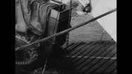 Allied tank being loaded into warship at harbour of south coast Stock Footage