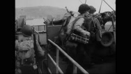 Allied soldiers boarding on warship at harbour of south coast Stock Footage
