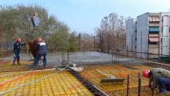 Concrete pouring at construction site Stock Footage