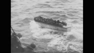 Allied soldiers sailing in landing craft in English Channel Stock Footage