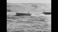 Allied landing crafts reaching beach at Normandy Stock Footage