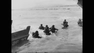 Allied soldiers landing on beach at Normandy Stock Footage