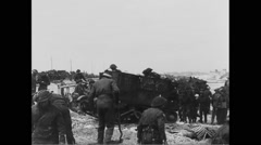 Allied soldiers working on beach at Normandy Free Stock Footage