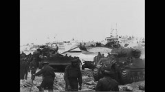 Allied military tanks moving on beach at Normandy Free Stock Footage