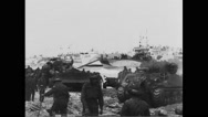 Allied military tanks moving on beach at Normandy Stock Footage