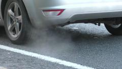 Smoke fumes from a car exhaust pipe - stock footage