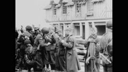 Allied soldiers inspecting German prisoners of war Stock Footage