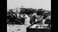 German prisoners of war walking towards beach Stock Footage