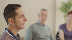 4K Mature people in group therapy session talk about their problems together Stock Footage