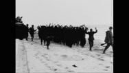 German prisoners of war walking on beach Stock Footage