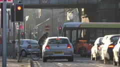 Cars waiting at traffic lights on a cold morning Stock Footage