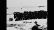 German prisoners of war on beach Stock Footage