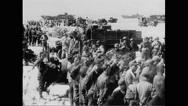 German prisoners of war on beach Stock Footage